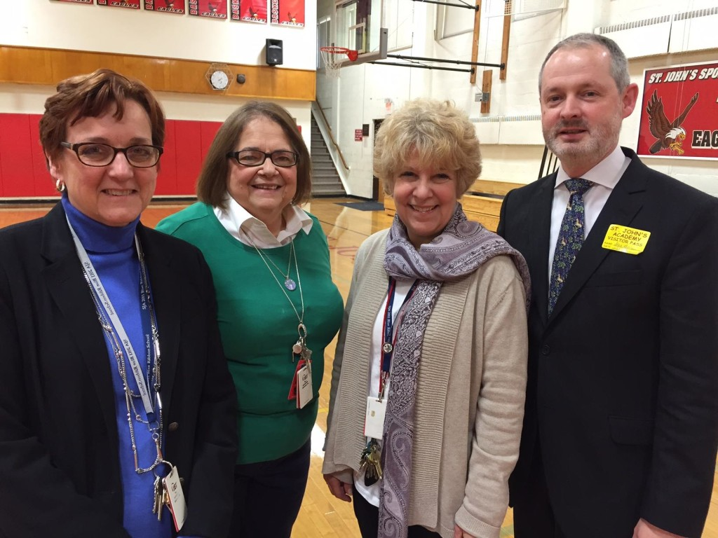 Alan Morley with Assistant Principal Sharon Gallagher (far left), Eugenia Absalom, 8th Grade teacher (second left), and Principal Elizabeth Viola (third from left)