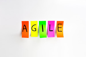 Image inscriptions of agile. Agile methodology writing colors stickers isolated on white background of white board.
